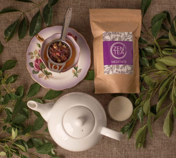 Creative arrangement of flowers tea cup