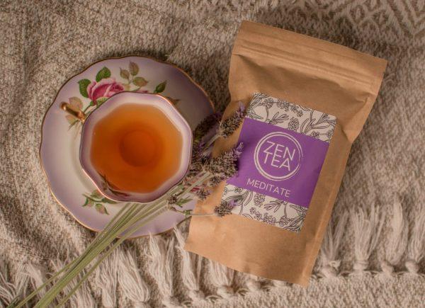 Creative arrangement of various flowers with tea cup.
